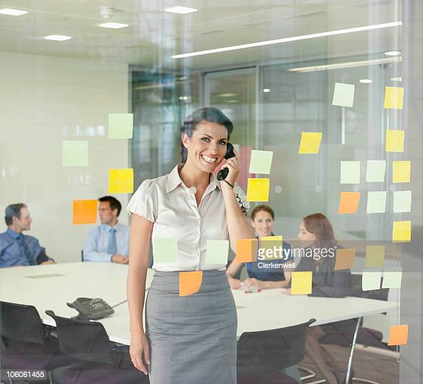 Portrait of a smiling businesswoman talking on telephone