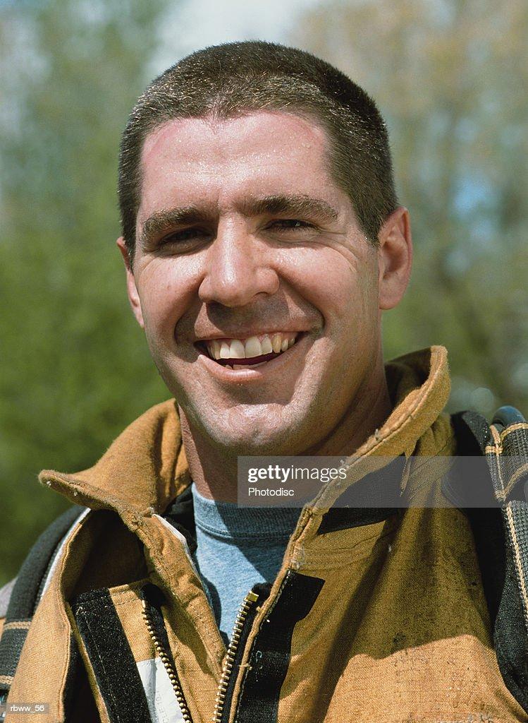 portrait of a smiling caucasian fireman : Foto de stock