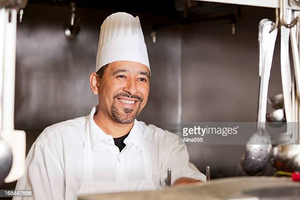 Portrait of a smiling chef inside the restaurant kitchen