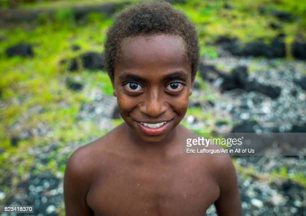 Portrait of a smiling child with Big eyes Malampa Province Ambrym island Vanuatu on August 28 2007 in Ambrym Island Vanuatu
