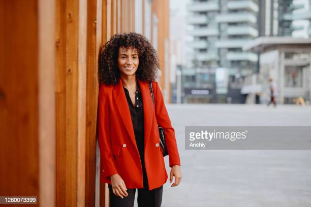 portrait of a smiling confident businesswoman - modern manhood stock pictures, royalty-free photos & images