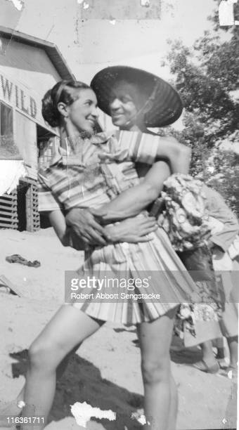 Portrait of a smiling couple as they embrace on the beach outside the Idlewild Club House Idlewild Michigan September 1938 Idlewild known as 'the...