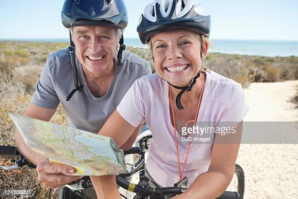Portrait of a smiling couple mountain biking