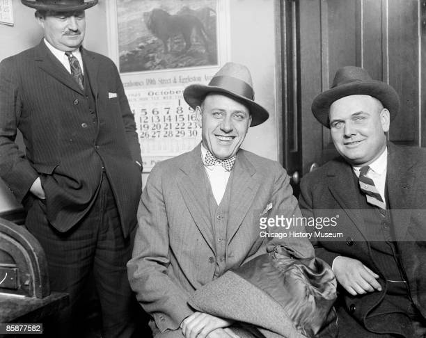 Portrait of a smiling Edward 'Spike' O'Donnell sitting with an unidentified man in a room in Chicago Illinois 1925 O'Donnell was a South Side...