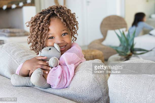 portrait of a smiling girl holding a teddy bear - onoky stock-fotos und bilder