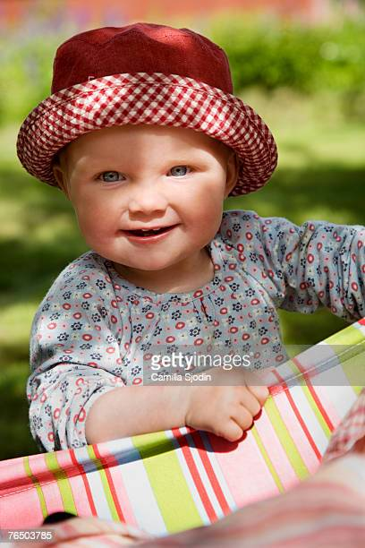 Portrait of a smiling girl wearing a sun hat Sweden.