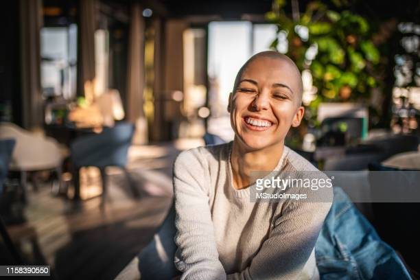 portrait of a smiling girl with short hair - completely bald stock pictures, royalty-free photos & images