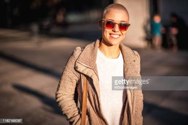 portrait of a smiling girl with short hair - alternative lifestyle stock pictures, royalty-free photos & images