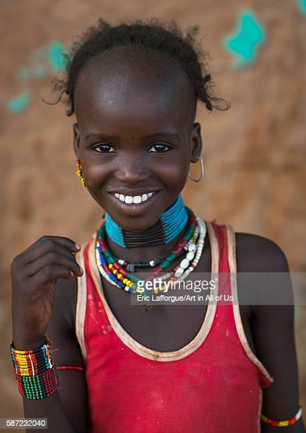 Portrait of a smiling hamer tribe girl omo valley turmi Ethiopia on March 14 2016 in Turmi Ethiopia