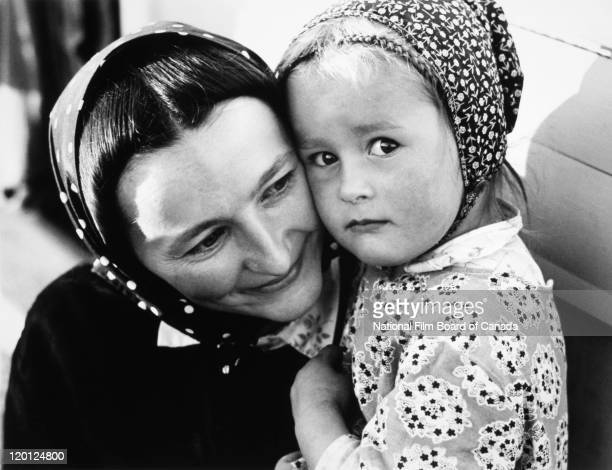 Portrait of a smiling Hutterite mother with her daughter Northeast Alberta Canada 1963 Photo taken during the National Film Board of Canada's...