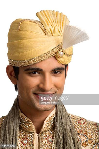 Portrait of a smiling Indian man in traditional wedding outfit