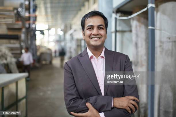 portrait of a smiling indian manufacturing manager - indian subcontinent ethnicity stock pictures, royalty-free photos & images