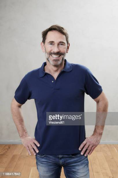 portrait of a smiling man, best ager - polo shirt stock pictures, royalty-free photos & images