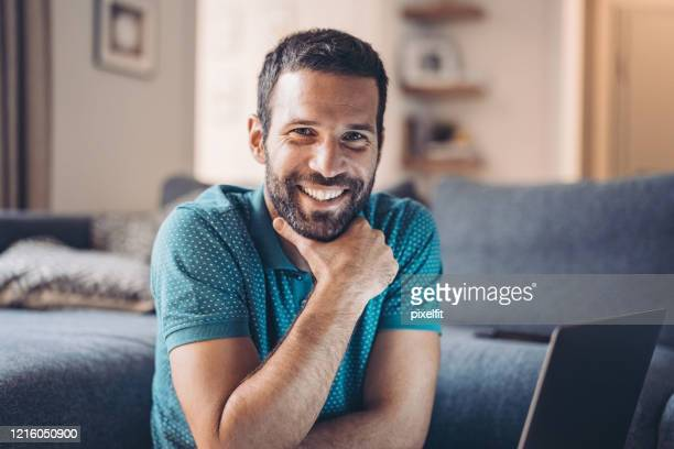 portrait of a smiling man - stay at home order stock pictures, royalty-free photos & images