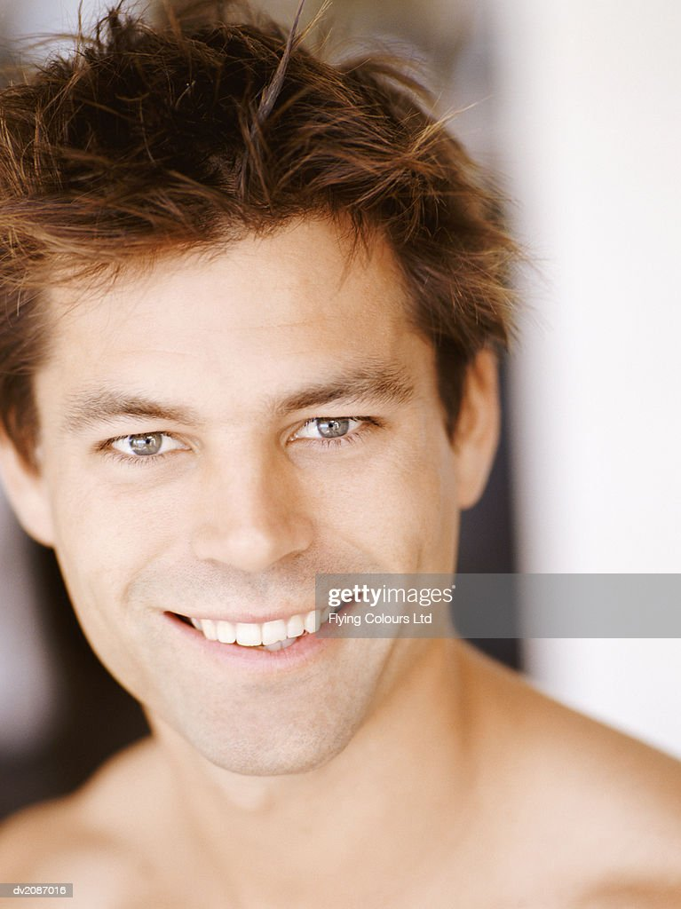 Portrait of a Smiling Man With Brown Hair : Stock Photo