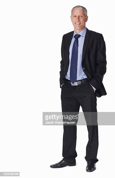 portrait of a smiling mature businessman - hands in pockets stock photos and pictures
