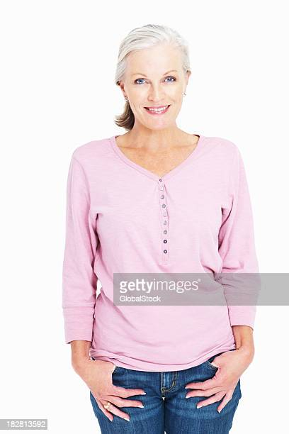 portrait of a smiling mature lady against white - hands in pockets stock pictures, royalty-free photos & images