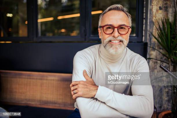 portrait of a smiling mature man. - handsome mexican men stock pictures, royalty-free photos & images