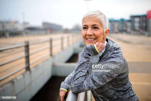 portrait of a smiling mature woman - 50 59 years stock pictures, royalty-free photos & images