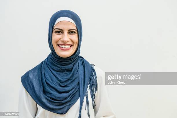 Portrait of a smiling Middle Eastern woman wearing an hijab