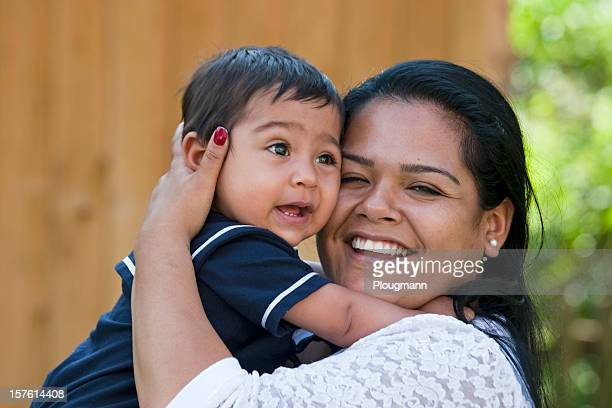 Portrait of a smiling mother holding her young son