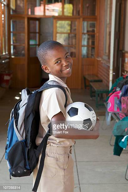 Portrait of a smiling schoolboy with his soccer ball, KwaZulu Natal Province, South Africa
