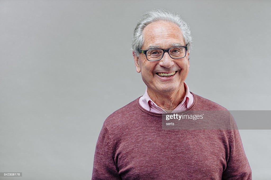 Porträt von einem lächelnden Senior Geschäftsmann : Stock-Foto
