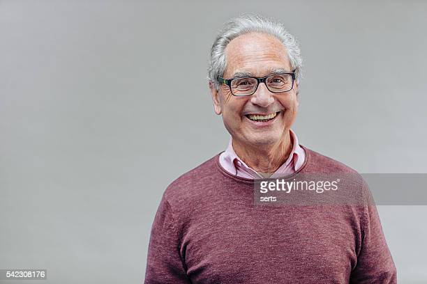 portrait of a smiling senior business man - oudere mannen stockfoto's en -beelden