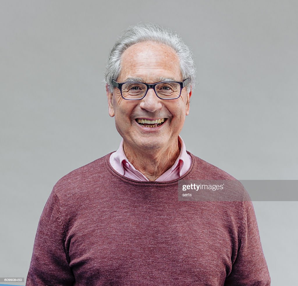 Portrait of a Smiling Senior Business Man : Stock Photo