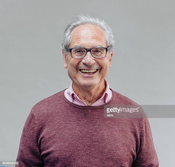 portrait of a smiling senior business man - only senior men stock pictures, royalty-free photos & images