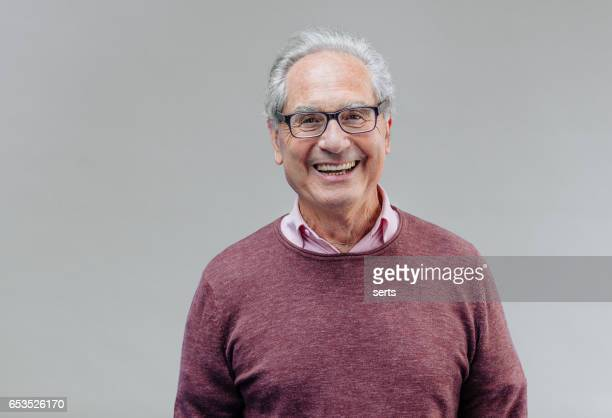 portrait of a smiling senior business man - gray background stock pictures, royalty-free photos & images