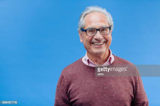 portrait of a smiling senior business man - colored background stock pictures, royalty-free photos & images
