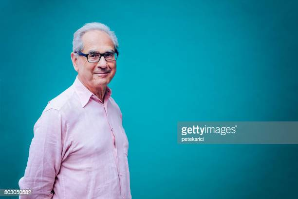 portrait of a smiling senior business man - one mature man only stock pictures, royalty-free photos & images