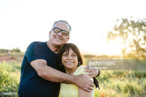 portrait of a smiling senior couple on the farm - ethnicity stock pictures, royalty-free photos & images