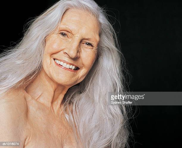 Portrait of a Smiling, Senior Female Nude With Long, Grey Hair