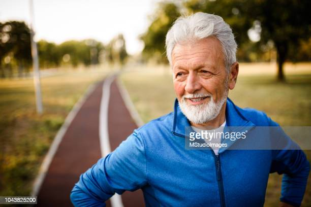 portrait of a smiling senior man. - mature men stock pictures, royalty-free photos & images