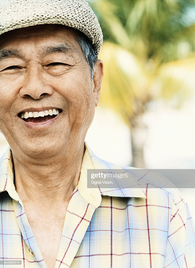 Portrait of a Smiling Senior Man Wearing a Flat Cap : Stock Photo