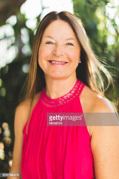 portrait of a smiling senior woman in summertime - one senior woman only stock pictures, royalty-free photos & images