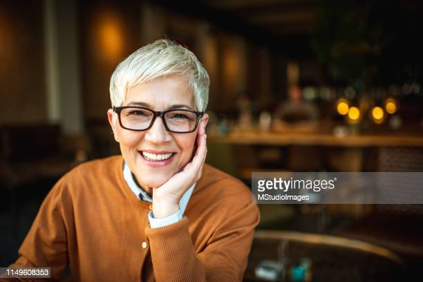 portrait of a smiling senior woman - dentures stock pictures, royalty-free photos & images