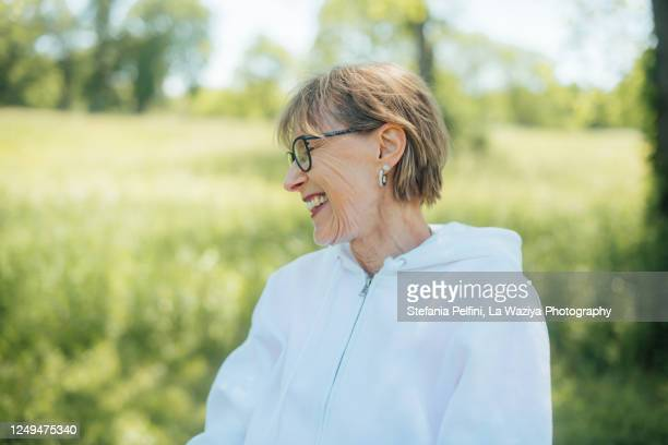 portrait of a smiling senior woman - disruptaging stock pictures, royalty-free photos & images