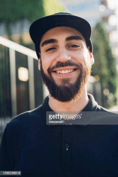 portrait of a smiling stylish young man - polo shirt stock pictures, royalty-free photos & images