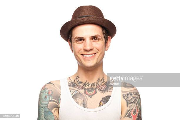 portrait of a smiling tattooed man - tattoo stock pictures, royalty-free photos & images
