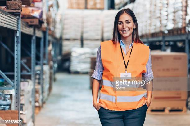portrait of a smiling warehouse manager - waistcoat stock photos and pictures