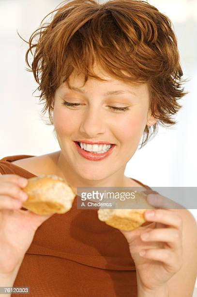 Portrait of a smiling woman, holding breads