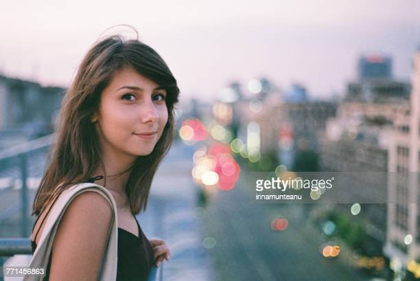 portrait of a smiling woman outdoors - one young woman only stock pictures, royalty-free photos & images