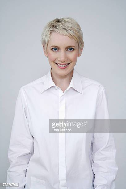 portrait of a smiling woman - blouse stockfoto's en -beelden