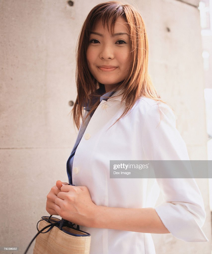 Portrait of a smiling woman, posing : Stock Photo