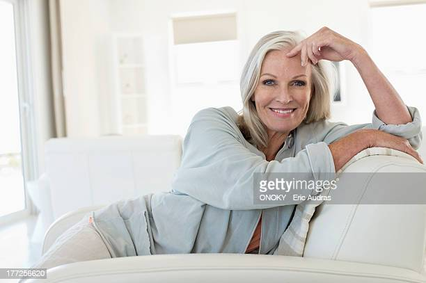 Portrait of a smiling woman sitting on a couch