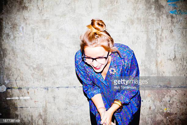 portrait of a smiling woman wearing glasses - youth culture stock pictures, royalty-free photos & images