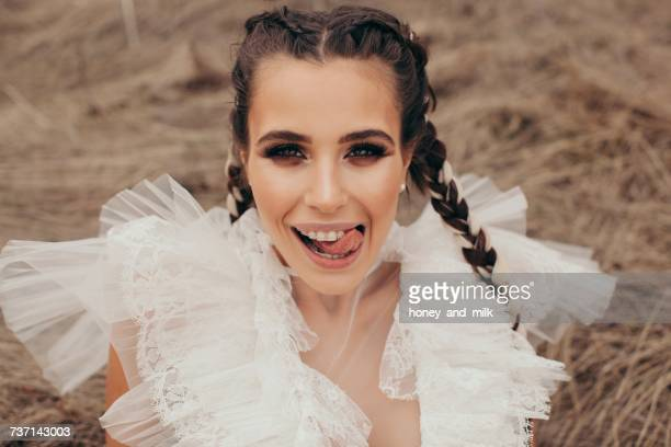 Portrait of a smiling woman with dental braces licking her lips